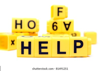An image of yellow bricks with word ''help'' on them