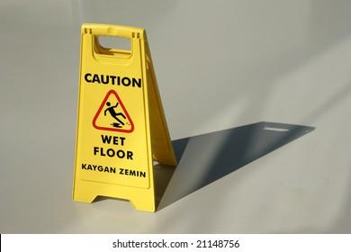 An image of yellow wet floor caution