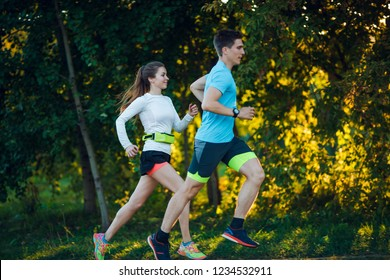 Image of young athlete woman and man running in park