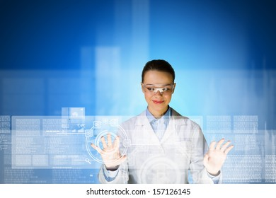 Image of young attractive woman scientist in protective eye wear