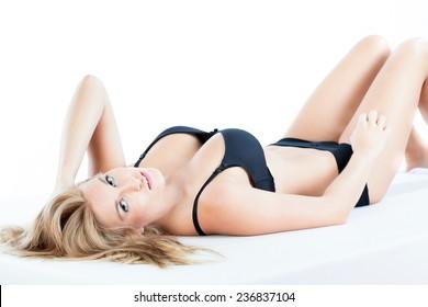 women beautifull lying on naked abdomen