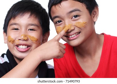 image of young boys with smeared faces