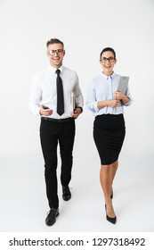 Image of young business happy colleagues couple isolated over white wall background.