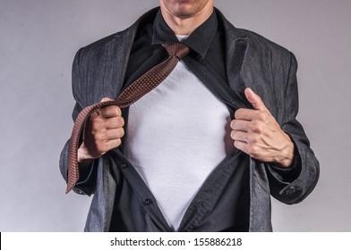 an image of young businessman pulls shirt