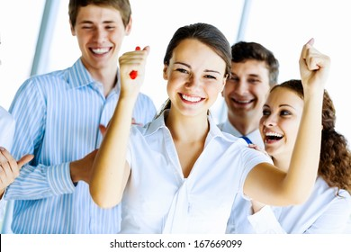Image of young businesspeople celebrating. Success concept