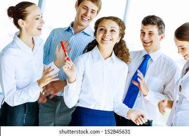 Image of young businesspeople congratulating colleague. Success concept
