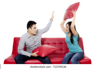 Image of young couple fighting in the couch, isolated on white background