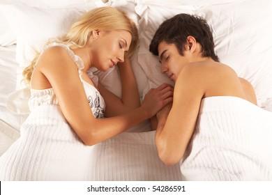 Image of young couple sleeping