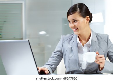 Image of young employer doing computer work in office
