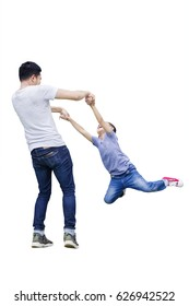 Image of young father is spinning his son in the studio, isolated on white background