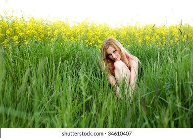 An image of a young girl sitting in the grass
