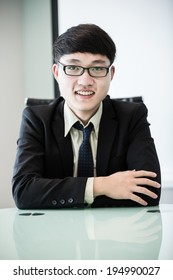 Image of young handsome confident businessman in suit.Asian
