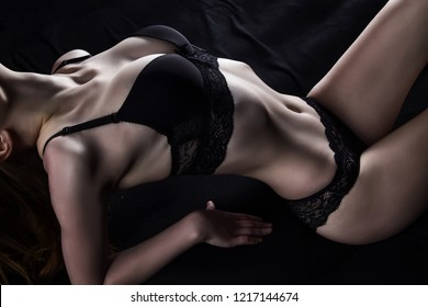 Image of young lying girl in sexual underwear