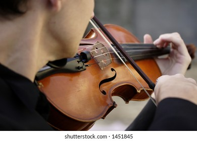 Image of a young man playing the violin