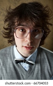 An image of a young man in very big glasses