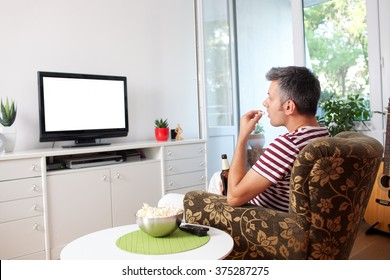Image of a young man watching TV