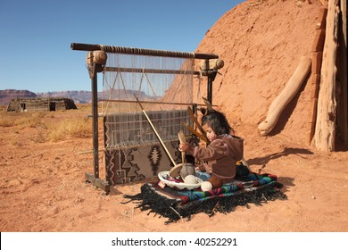 Image of a young Native American girl using a loom to weave a blanket. She is looking away from the camera and full length viewable. Horizontally framed shot.