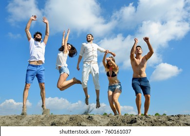 Image of young people jumping together outdoor.