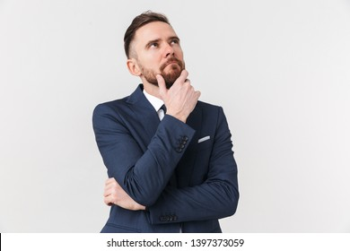 Image of young thinking businessman posing isolated over white wall background.