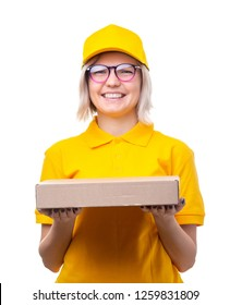 Image of young woman courier with glasses and yellow T-shirt with box in her hands