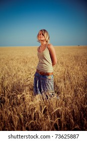 Image of young woman on wheat field