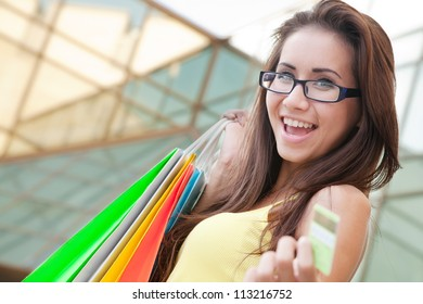 Image of a young woman with shopping bags