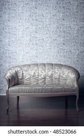 Images of the glamorous sofa in the background of vintage wallpaper