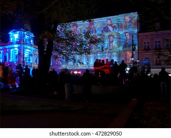 Images of light. Lodz, Poland October 10, 2015 Residents of Lodz and tourists watching imaging illumination on the wall of the building at Piotrkowska Street, the festival of light art in 2015.