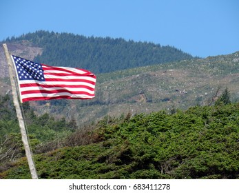 IMAGES OF OREGON COAST FROM HIGH MOUNTAIN CLIFF WITH FLAG