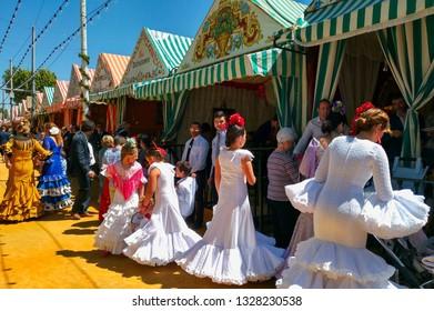 Images from Seville's April Fair, from Seville, Spain, May 2017: Women in White Sevillan dresses