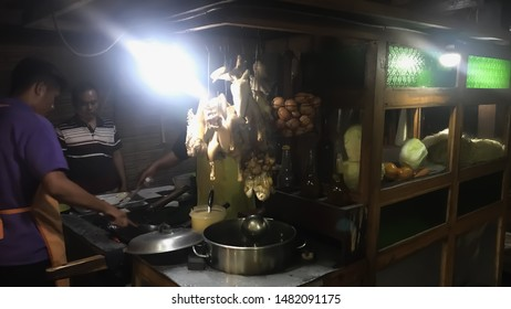 Images of Warung Bakmi Djowo or Javanese Noodle Soup street side stall. Photographed in lowlights, slow shutter.