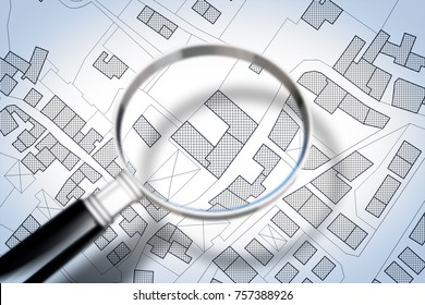 Imaginary cadastral map of territory with buildings and roads through magnifying glass