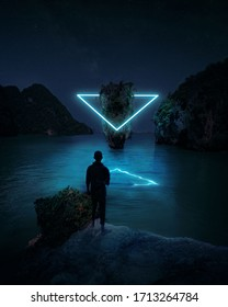 Imaginary World - Wanderer Standing On A Rock In A Futuristic Alien World And Watching An Illuminated Neon Triangle In The Imaginations - Ao Phang Nga National Park In Phuket, Thailand