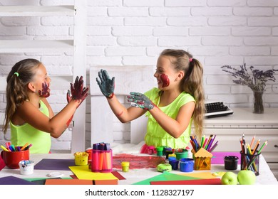 Imagination, creativity and freedom concept. Children happy smiling with colored hands. Arts and crafts. Girls painters painting with gouache paints on table. Kids learning and playing.