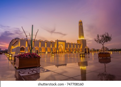 Imam Muhammad ibn Abd al-Wahhab Mosque (Qatar State Mosque) exterior view at sunset with clouds in the sky