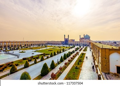 Imam Square viewed from Ali Qapu in Isfahan, Iran. It is known as Naqsh-e Jahan Square. It has led to its designation as a UNESCO World Heritage Site.
