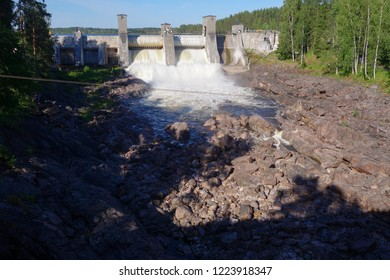 Imatra, Finland - June 3, 2015: Water starting to flow through Imatrankoski rapids from dam on sunny July summer afternoon in 2015.