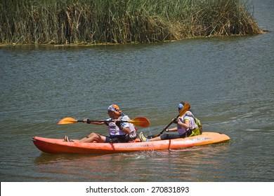 IMBABURA, ECUADOR - FEBRUARY 15, 2010: Unidentified tourists kayaking in Yahuarcocha lake, Imbabura province.