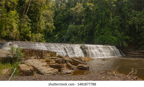 Imbak Falls or Muddy 30m-wide waterfall in rainforest, located at the entrance to Imbak Canyon, Tongod, Sabah - Borneo, Malaysia. Borneo Tropical Rainforest Waterfall