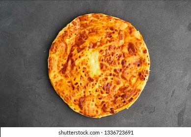 Imeretian (Imeruli) khachapuri - traditional Georgian cheese pastry. Homemade baking.