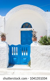Imerovigli, Santorini, Greece, June 2008:  Blue gate and door on domed roofed house on the Greek Island of Santorini.