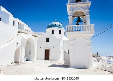 Imerovigli, Santorini, Greece, June 2008:  Imerovigli Church with Blue dome and bell tower.
