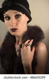 An imitation of the famous Actresses of the silent era of old Hollywood portrait girl makeup luxury movie star