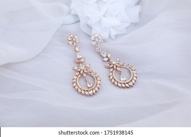 Imitation jewelry in white background - long diamond, rose gold, silver, oxidase earrings