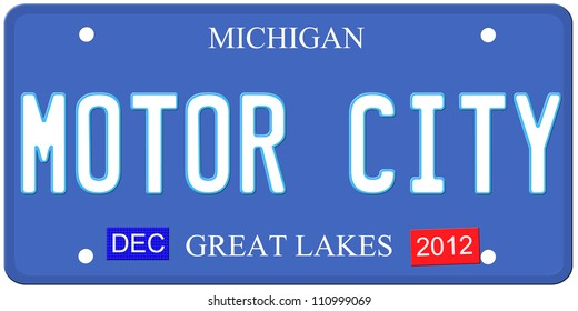 An imitation Michigan license plate with December 2012 stickers and Motor City written on it making a great Detroit or Michigan auto concept.  Words on the bottom Great Lakes.
