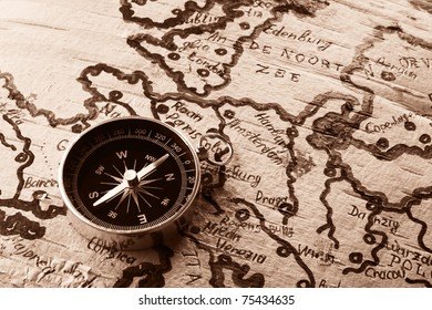 Imitation of old map on birch cork and compass