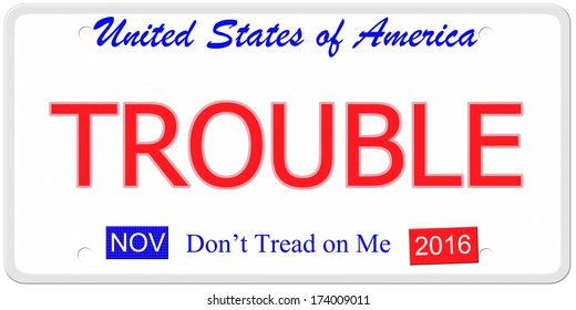An imitation United States license plate with the word TROUBLE and  November 2016.  Don't tread on me on bottom.
