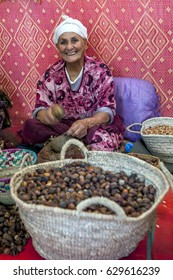 IMLIL, MOROCCO - AUGUST 01, 2013 : A lady cracks chestnuts in a co-operative factory near Ilmil. The co-op was established to give Moroccan women the opportunity to earn their own income.