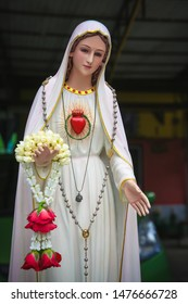 Immaculate heart of Virgin Mary catholic statue