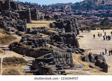 Immense rocks carved and perfectly assembled in the archaeological field of Sacsayhuaman, Cusco, Peru